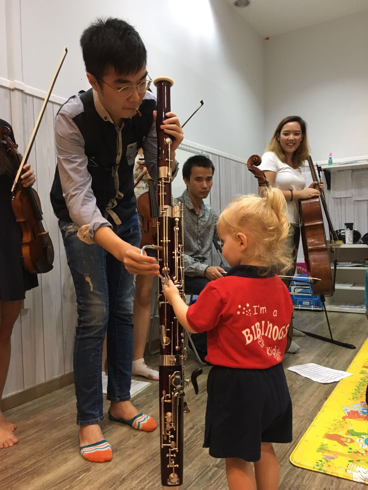 The bassoon is taller than the child! We are all fascinated by the bassoon's appearance and sound.