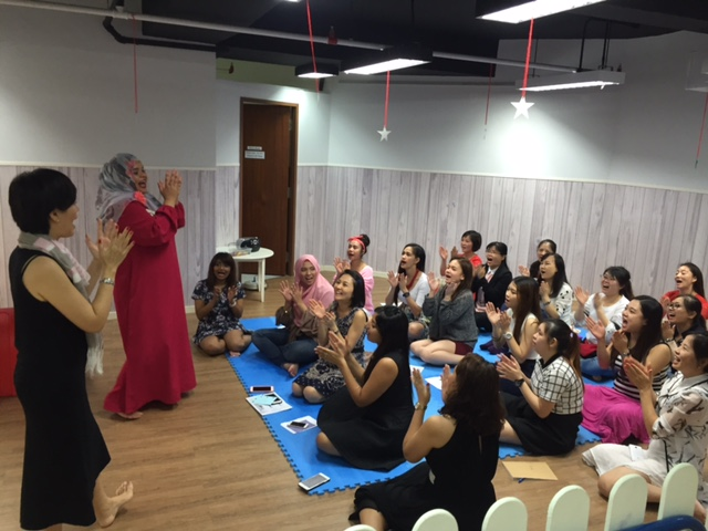 Teacher Yani shows what it's like to be in a Laughter Yoga class – we laughed our way to good health and sprightly spirits.
